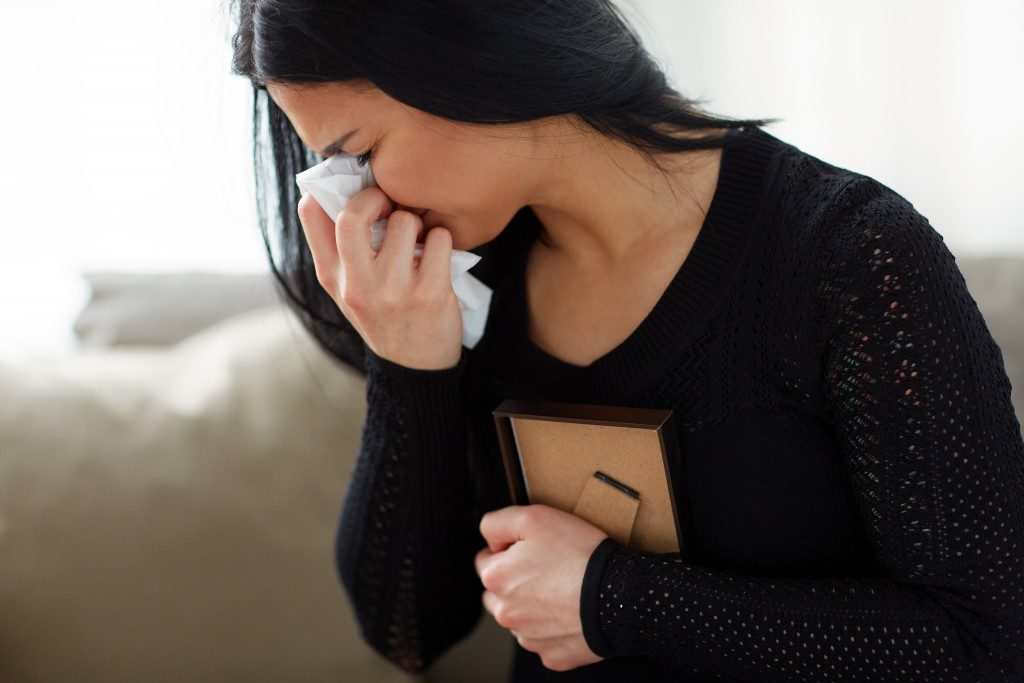 Woman crying in grief