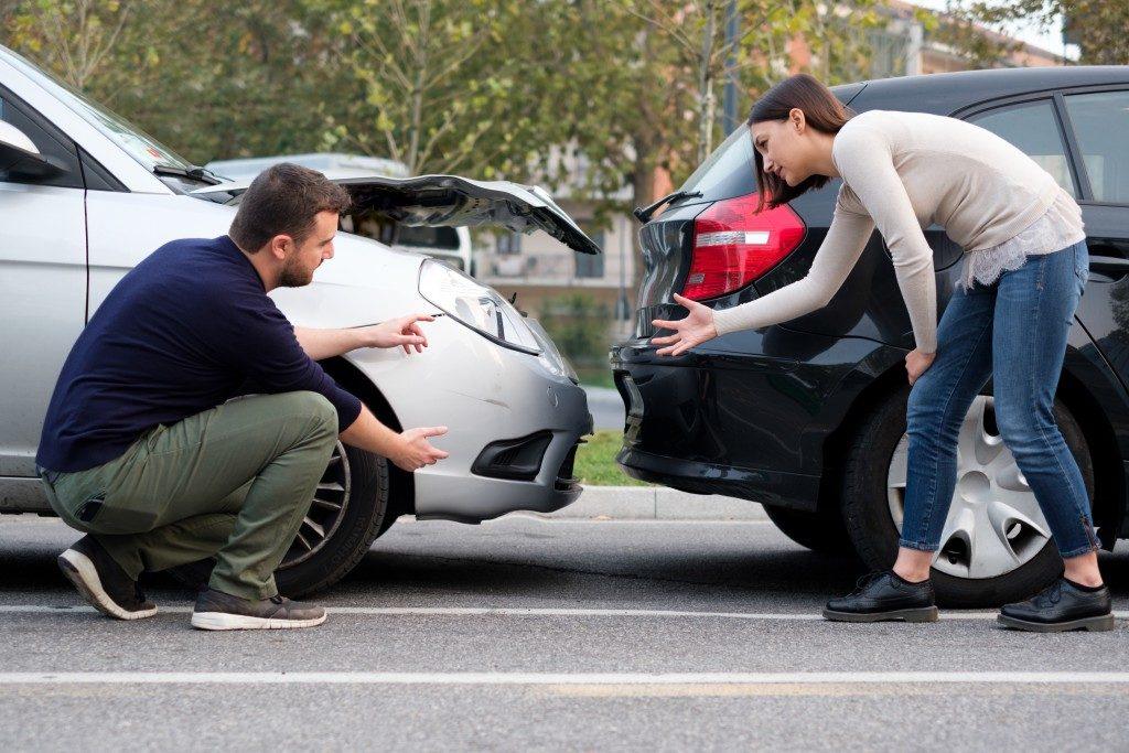 Involved people in car crash talking