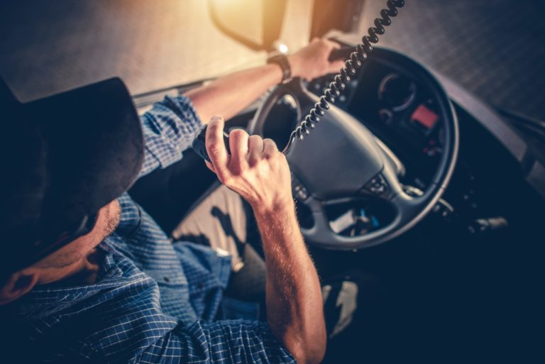 Man talking on the radio while driving a truck