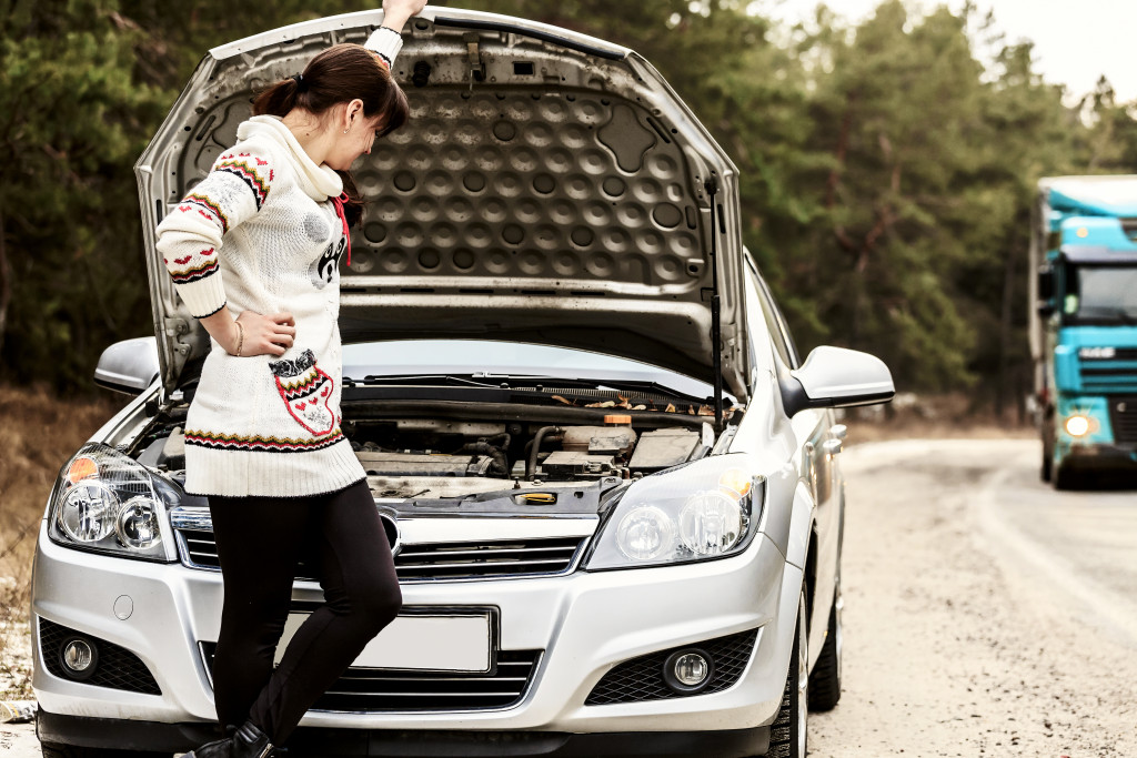 woman inspecting her car