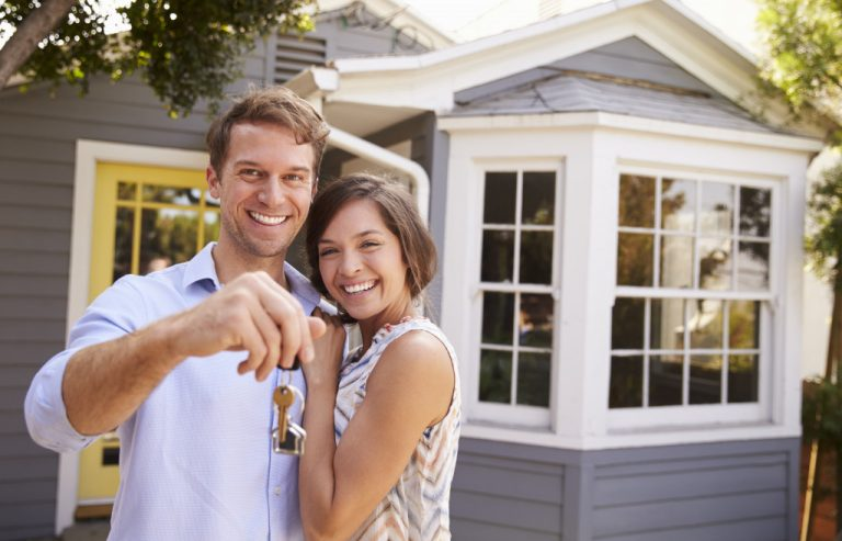 couple in front of their house